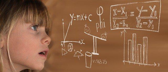 Child staring at equations